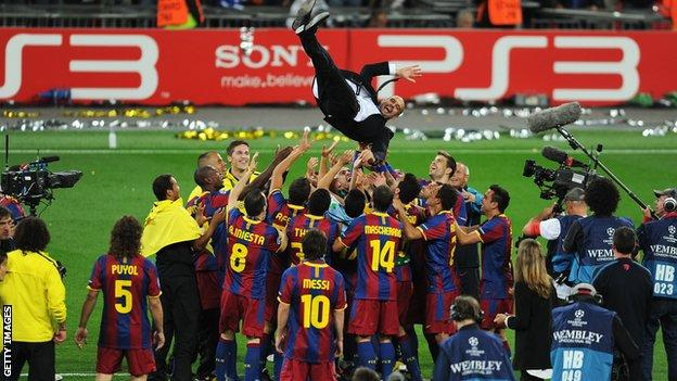 Barcelona players throw Pep Guardiola into the air