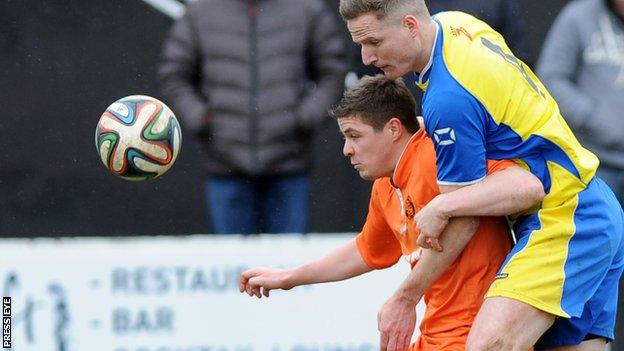 Carrick's Ben Roy is challenged by Bangor opponent Thomas Wray
