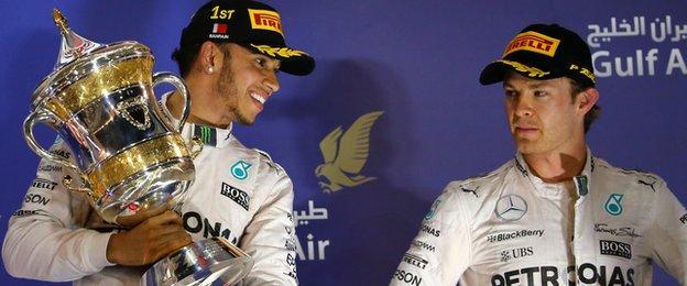 Lewis Hamilton celebrates his win at the Bahrain Grand Prix as Nico Rosberg looks on