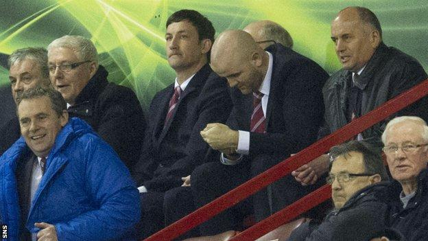 Martin Canning (centre) had to watch from the stand while serving a suspension