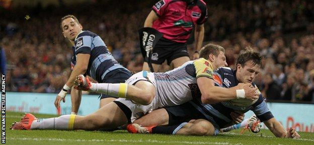 Garyn Smith of Cardiff Blues is pushed into touch just shy of the try line by Dan Biggar of Ospreys
