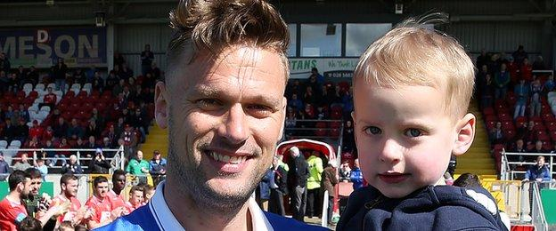 Peter Thompson, pictured with four-year-old son Jacob, made his final appearance for Linfield at Shamrock Park
