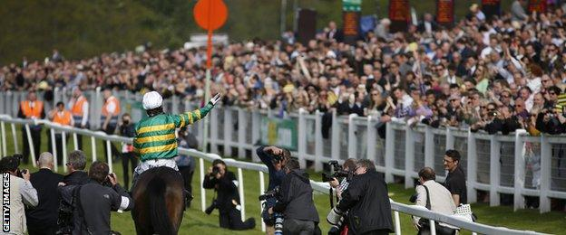 McCoy salutes the Sandown crowd after his final race