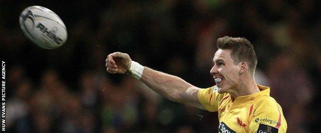 Liam Williams celebrates his try against the Dragons