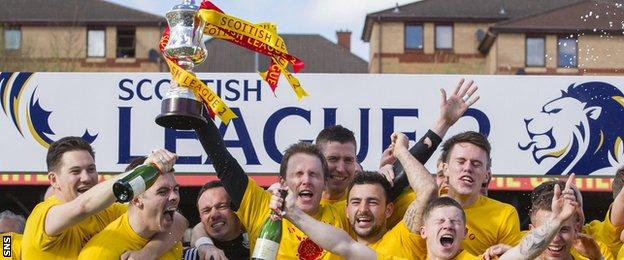 Albion Rovers players celebrate with the Scottish League Two trophy