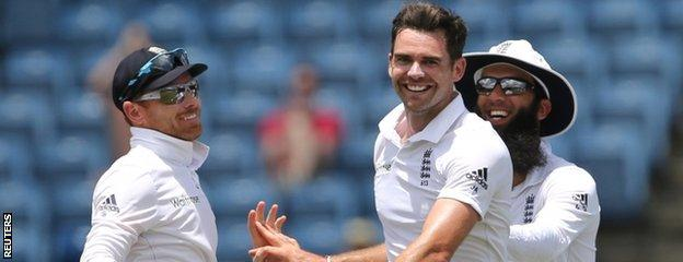 James Anderson celebrates with Ian Bell (left) and Moeen Ali (right)
