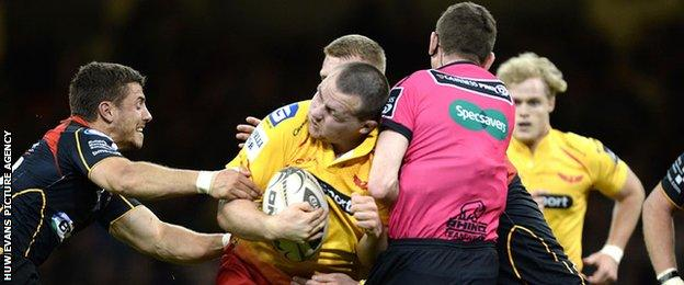 Ken Owens runs into George Clancy on the way to his try