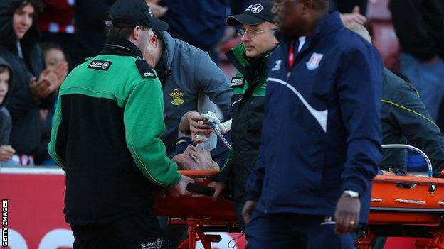 Toby Alderweireld is stretchered off during his side's loss against Stoke