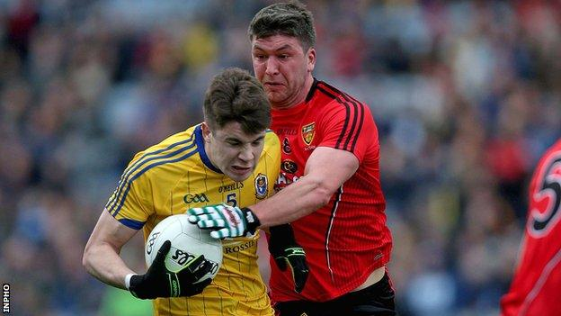 Roscommon's Conor Daly is challenged by Down's Paul Devlin in the Division 2 Football League final