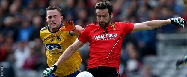 Down's Kevin McKernan tries to burst away from Roscommon's Kevin Higgins at Croke Park