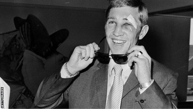 Ken Buchanan removes his sunglasses on his arrival at London's Heathrow airport, to show his cuts and bruises after the successful 1971 defence of his world lightweight crown against Panama's Ismael Laguna in New York
