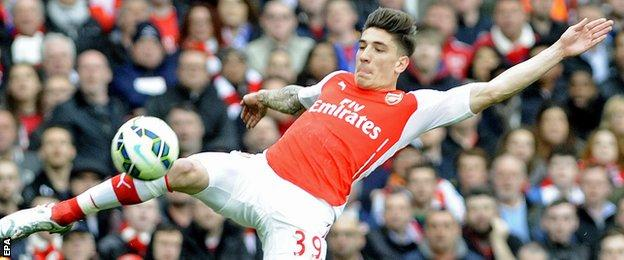Arsenal defender Hector Bellerin reaches for the ball