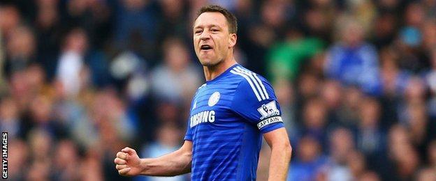 John Terry celebrates Chelsea's draw at Arsenal