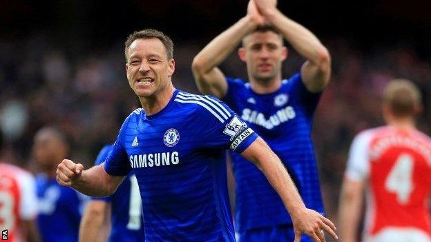 John Terry celebrates his team's point at Arsenal
