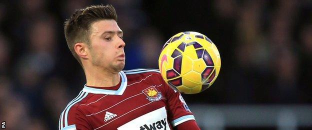 Aaron Cresswell controls the ball