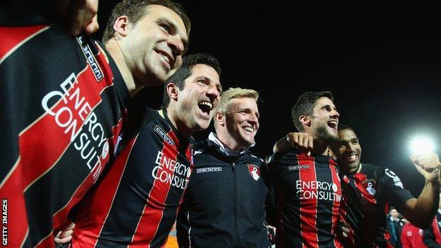 Eddie Howe celebrates with players