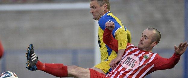 Bangor defender Colin Nixon and Stephen Hughes battle for possession in the first leg