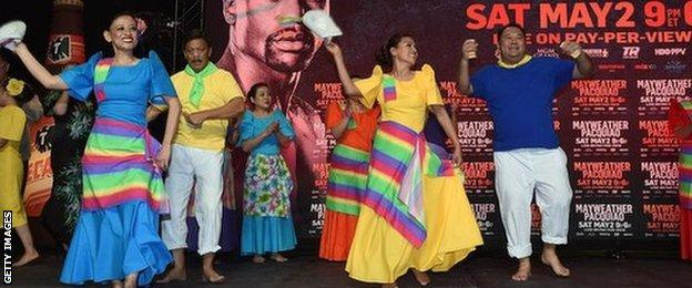 Filipino dancers at a Pacquiao fans rally