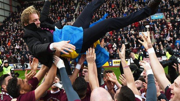 Hearts manager Robbie Neilson is lifted about his Championship-winning players