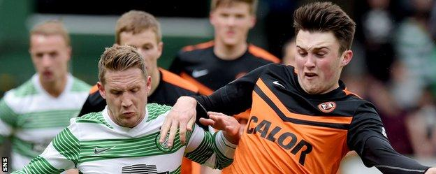 Celtic's Kris Commons is challenged by Dundee United's John Souttar