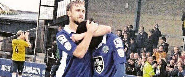 Scott Barrow consoles Adriano Moke as Macclesfield Town miss out on the play-offs