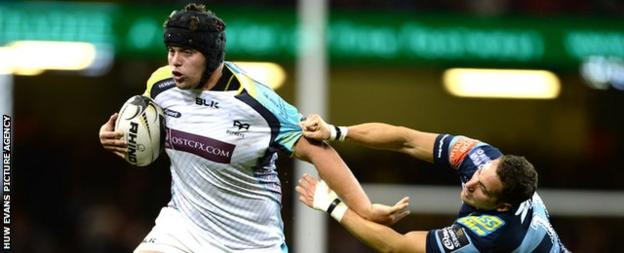 Nicky Smith (left) hands off Cardiff Blues winger Joaquin Tuculet