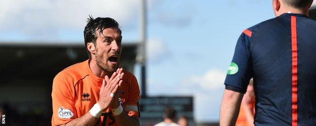 Kilmarnock defender Manuel Pascali pleads with an official