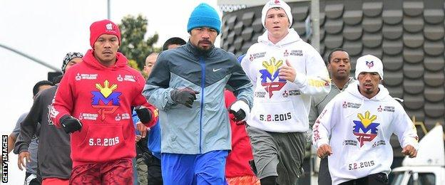 Pacquiao (centre) and support team on a morning jog