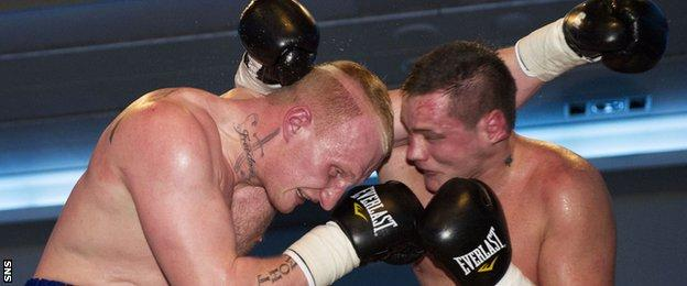 Gary Cornish (left) clashes with opponent Tamas Bajzath in January