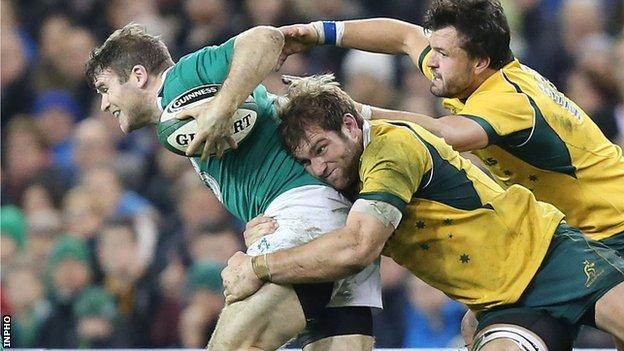 Gordon D'Arcy is tackled by Australian pair Adam Ashley-Cooper and Ben McCalman