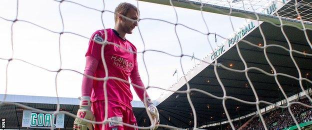 Dundee goalkeeper Scott Bain was beaten five times at Celtic Park