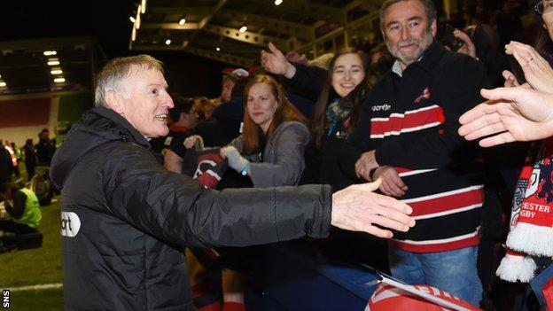 Edinburgh head coach Alan Solomons shakes hands with the travelling support at full-time
