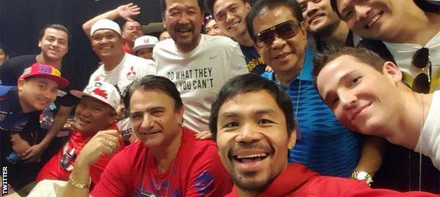 A relaxed Pacquiao takes a selfie before the weigh-in