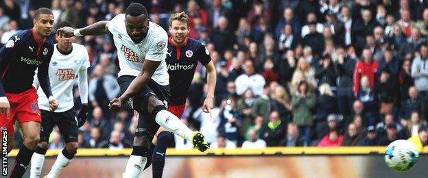 Darren Bent shoots towards goal for Derby against Reading