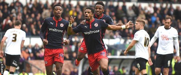 Reading's players celebrate their third goal against Derby