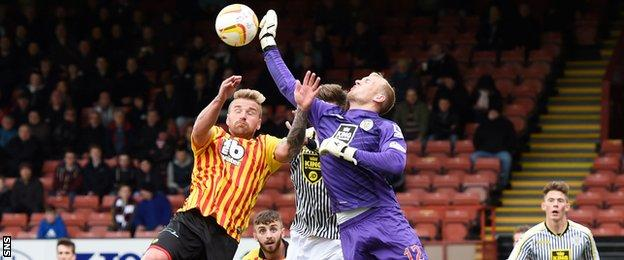 Partick Thistle's Ryan Stevenson challenges for the ball with Mark Ridgers