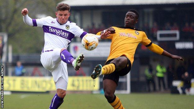 David Tutonda of Newport County challenges Alex McDonald of Oxford United