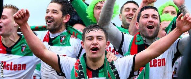 Jordan Stewart leads the celebrations after Glentoran's cup final victory over Portadown