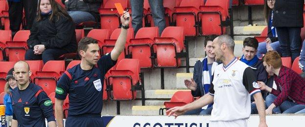 Inverness Caledonian Thistle defender David Raven is shown a red card against St Johnstone