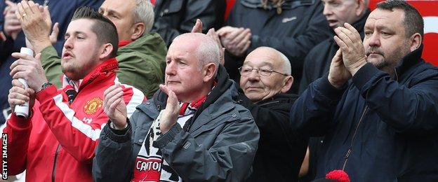 Manchester United fans paid tribute with a minute's applause in the fifth minute
