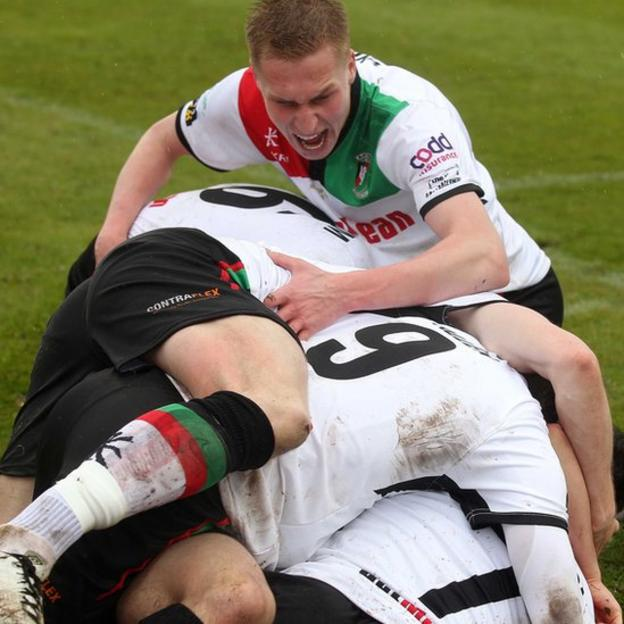 Glentoran players celebrate after David Scullion had scored the winner against Portadown in the 2015 Irish Cup final