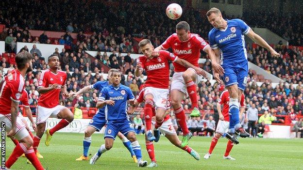 Cardiff defender Ben Turner goes close to scoring with a header against Nottingham Forest
