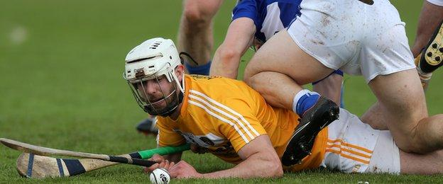 Antrim's Neil McManus and Laois full-back Cahir Healy hit the deck during the match in Ballycastle