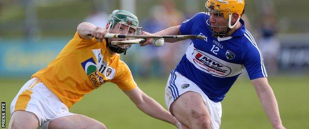 Charles Dwyer of Laois in action against Antrim's Paul Shiels during the Leinster Championship match