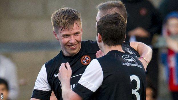 Jordan Moore celebrates with Dundee United