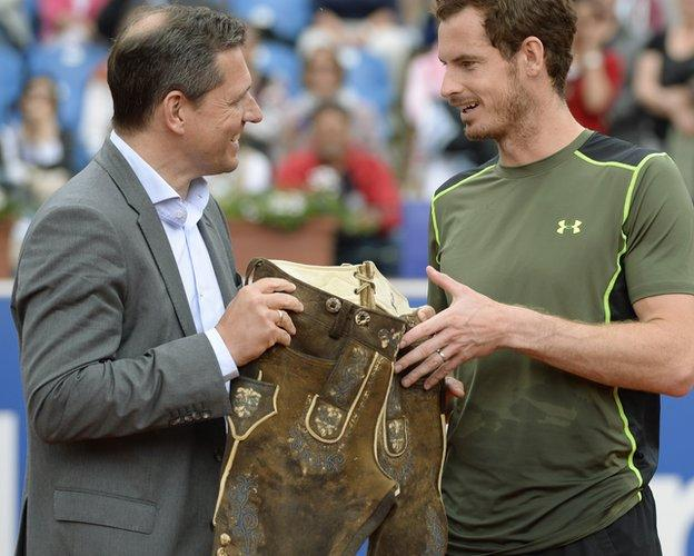 Andy Murray wins Munich Open, presented with a pair of lederhosen