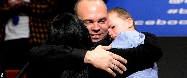 Bingham celebrates with his wife Michelle and son