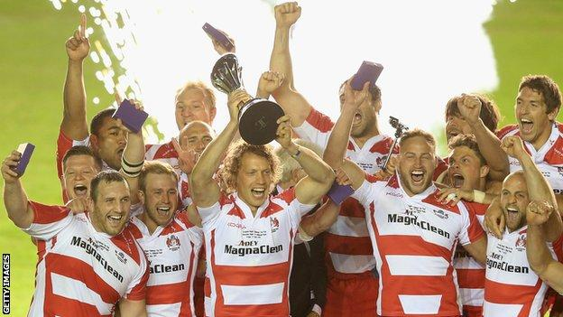 Gloucester players celebrate their European Challenge Cup final win against Edinburgh at the Twickenham Stoop
