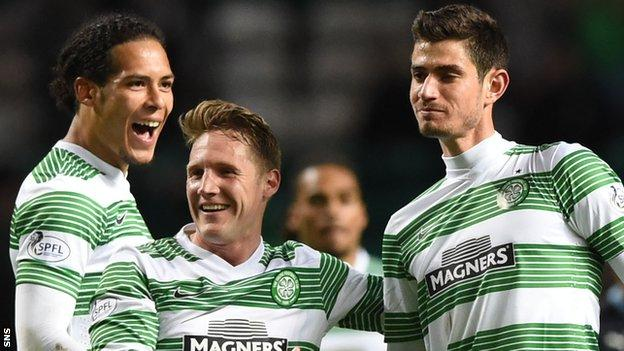 Virgil van Dijk, Kris Commons and Nir Bitton celebrate
