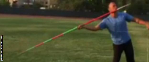 With Clay holding the string, attached to the Javelin, he throws into the distance